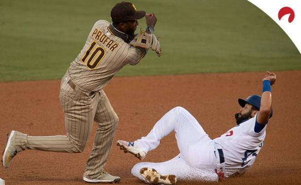 San Diego Padres second baseman Jurickson Profar, left, turns a double play over Los Angeles Dodgers Edwin Rios.
