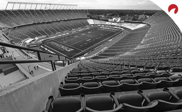Black and white photo of an empty Commonwealth Stadium in Edmonton