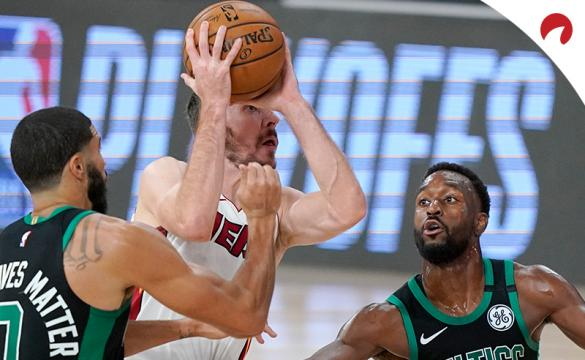 Boston Celtics' Jayson Tatum (0) and Kemba Walker, right, defend as Miami Heat's Goran Dragic, center, drives to the basket during an NBA conference final playoff game, Tuesday, Sept. 15, 2020.