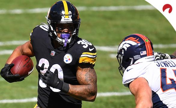 James Conner (30) of the Pittsburgh Steelers carries the ball in front of Josey Jewell (47) of the Denver Broncos in a game at Heinz Field on September 20, 2020, in Pittsburgh.