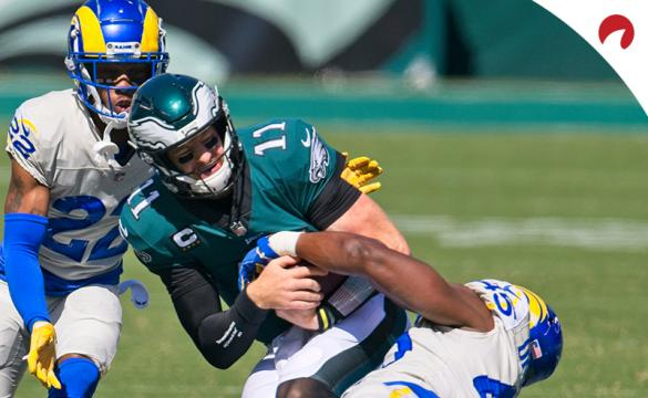 Philadelphia Eagles quarterback Carson Wentz (11) is tackled by Los Angeles Rams linebacker Obo Okoronkwo (45) during an NFL game on September 20, 2020, at Lincoln Financial Field in Philadelphia.
