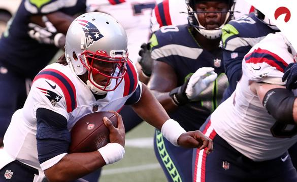 Cam Newton (1) of the New England Patriots runs with the ball during a game against the Seattle Seahawks at CenturyLink Field on September 20, 2020, in Seattle, Washington.