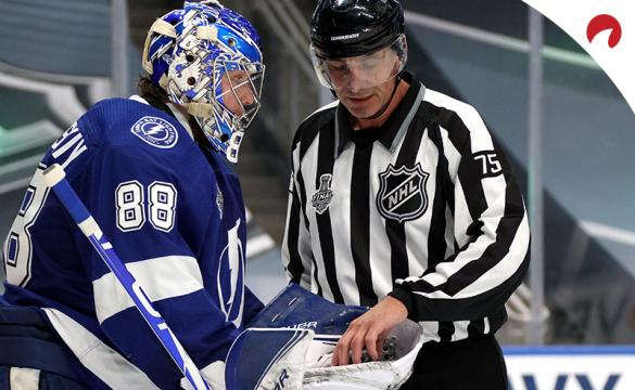 Goaltender Andrei Vasilevskiy of the Tampa Bay Lightning gives the puck to linesman Derek Amellduring a break in Game 2 of the NHL Stanley Cup Final between the Dallas Stars and the Lightning at Rogers Place on September 21, 2020. in Edmonton, Alberta, Canada.