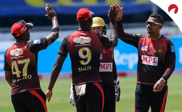 Sunil Narine (R) and Jayden Seales (2L) of Trinbago Knight Riders celebrate the dismissal of Shai Hope of Barbados Tridents during the Hero Caribbean Premier League.