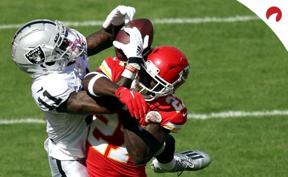 Henry Ruggs III (11) of the Las Vegas Raiders catches a 46-yard pass against Rashad Fenton (27) of the Kansas City Chiefs during an NFL game at Arrowhead Stadium on October 11, 2020 in Kansas City, Missouri.