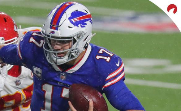 Josh Allen of the Buffalo Bills evades a tackle in a game against the Kansas City Chiefs.