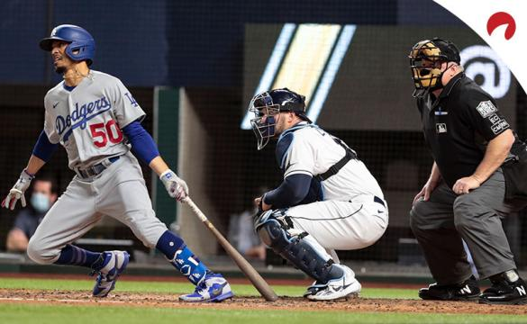 Mookie Betts of the Los Angeles Dodgers hits a single against the Tampa Bay Rays in the World Series.
