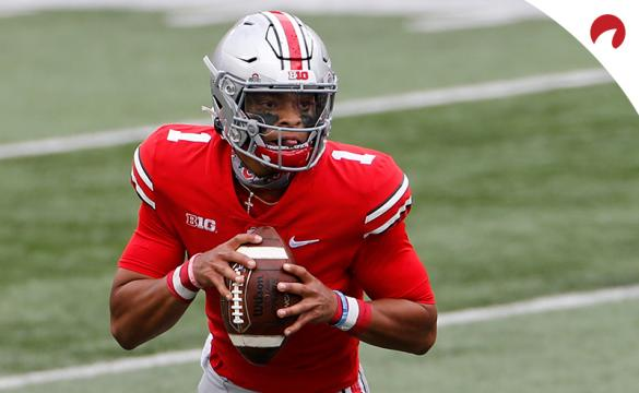 Big 10 NCAAF Betting Odds Justin Fields scrambling in the pocket