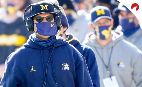 Wisconsin vs Michigan NCAAF Betting Odds Jim Harbaugh on the Michigan sideline