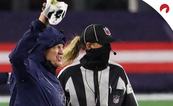 Head coach Bill Belichick of the New England Patriots argues a call with line judge Sarah Thomas during a game against the Baltimore Ravens at Gillette Stadium on November 15, 2020, in Foxborough, Mass.