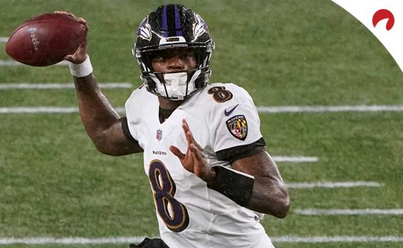 Baltimore Ravens quarterback Lamar Jackson rolls out to pass against the New England Patriots during an NFL football game, Sunday, Nov. 15, 2020, in Foxborough, Mass.