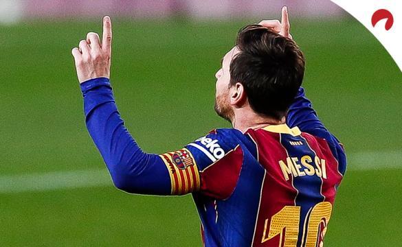 Lionel Messi of FC Barcelona celebrates scoring his side's third goal during the La Liga Santader match between FC Barcelona and Real Betis at Camp Nou on November 7, 2020 in Barcelona, Spain.