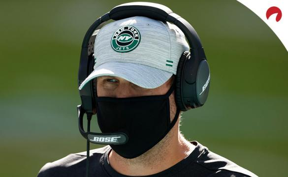 Adam Gase watches a game between the New York Jets and Miami Dolphins.