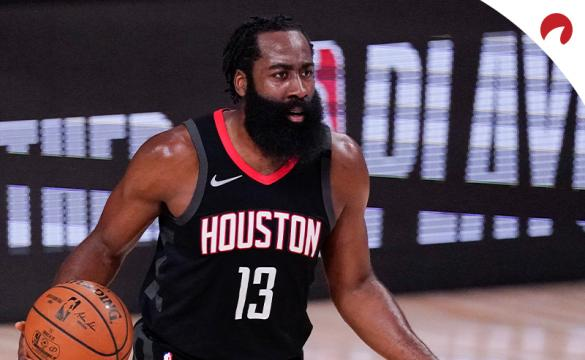 Houston Rockets James Harden dribbling up the court trying to setup the offense.
