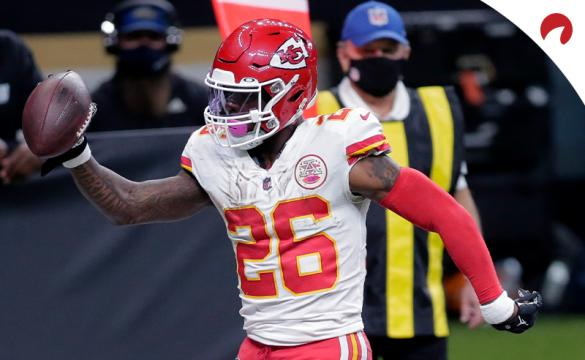Kansas City Chiefs running back Le'Veon Bell (26) crosses the goal line past New Orleans Saints outside linebacker Kwon Alexander (58) on a touchdown carry in an NFL football game in New Orleans on Dec. 20, 2020.