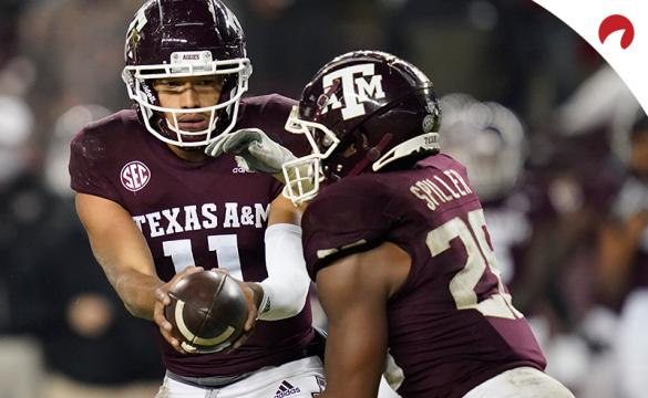 Texas A&M quarterback Kellen Mond (11) hands the ball off to running back Isaiah Spiller (28) during an NCAA college football game against LSU on Nov. 28, 2020, in College Station, Texas.