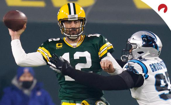 Green Bay Packers' Aaron Rodgers throws under pressure during an NFL football game against the Carolina Panthers on Dec. 19, 2020, in Green Bay, Wis.