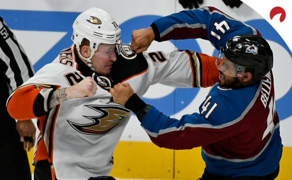 Anaheim Ducks left wing Nicolas Deslauriers (20) and Colorado Avalanche center Pierre-Edouard Bellemare (41) exchange blows during the first period in an NHL hockey game.