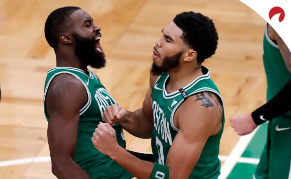 Jaylen Brown and Jaysom Tatum with the Boston Celtics celebrate a victory as home underdogs.
