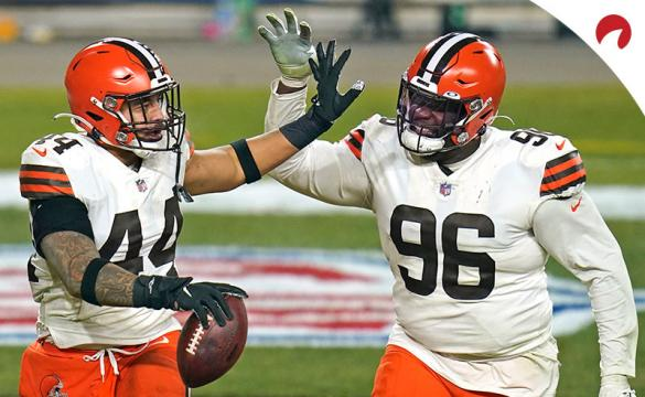 A pair of Cleveland Browns defenders celebrate after an interception from Ben Roethlisberger of the Pittsburgh Steelers.