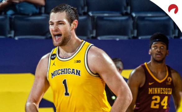 Hunter Dickinson for Michigan Wolverines celebrates a made basket.