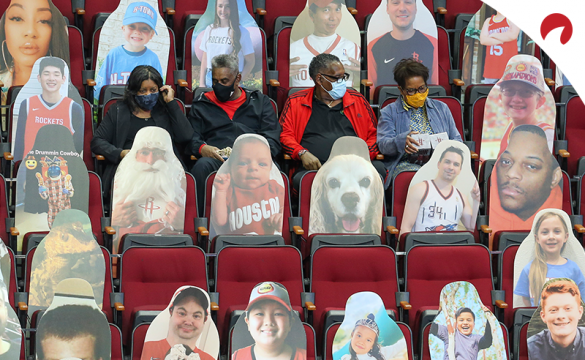 Fans sit between cardboard cutouts before the Minnesota Timberwolves and the Houston Rockets in April, 2021.