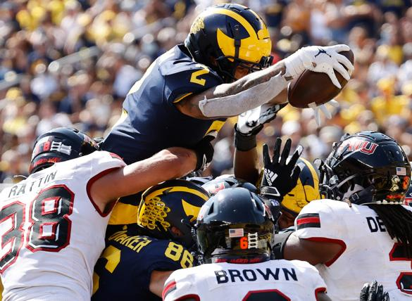 Blake Corum and theMichigan Wolverines are big favorites over theNorthwestern Wildcats in NCAAF betting odds.